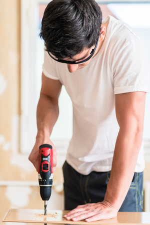 drill floor: Craftsman or DIY man working with power drill