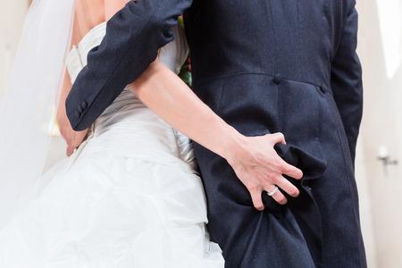 grabbing: Bride grabbing ass of groom at wedding in church