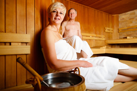 sauna: Seniors in sauna sweating and relaxing Stock Photo