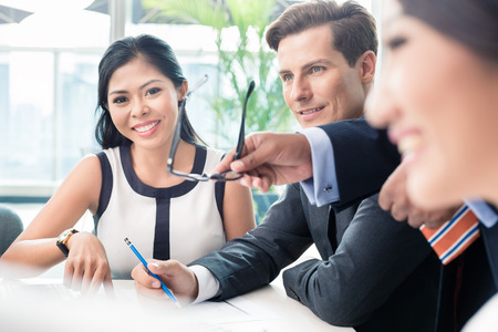 asian businesswoman: Business people discussing in meeting, diverse ethnicities Stock Photo