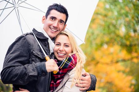 despite: Couple enjoying fall day having walk despite the rain