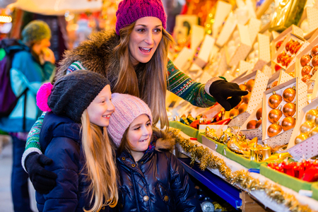 Family buying on Christmas market decoration