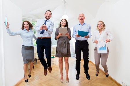 Office women: Group of women and men in office jumping