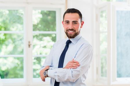 man business: Businessman in stylish office