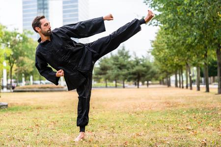 qigong: Martial artist practicing Qigong in office break