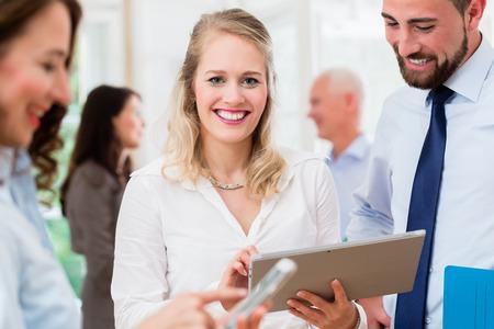 informal: Business people in office having informal meeting and short presentation
