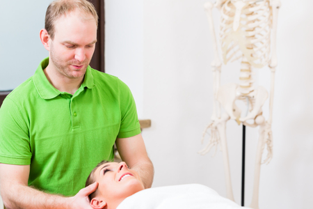alternative practitioner: Physiotherapist massaging womans face in treatment