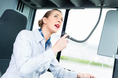 drivers seat: bus driver with microphone
