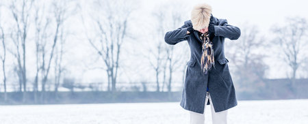 burnout: Senior woman with burnout in winter