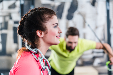 functional: Woman at Functional Training with chain and rings in gym