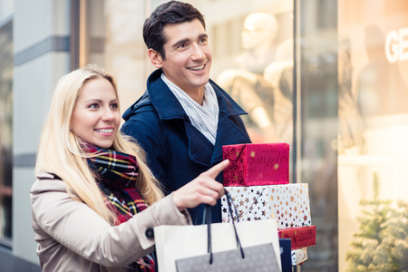 Couple at shop window doing Christmas shopping Stock Photo