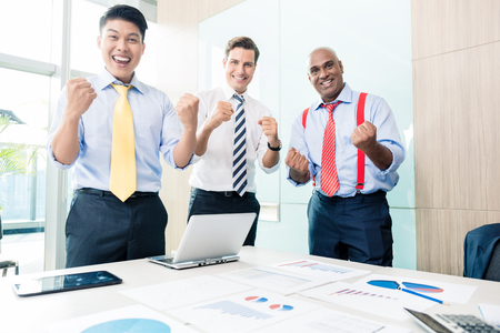business asia: Indian CEO reporting success in business meeting Stock Photo