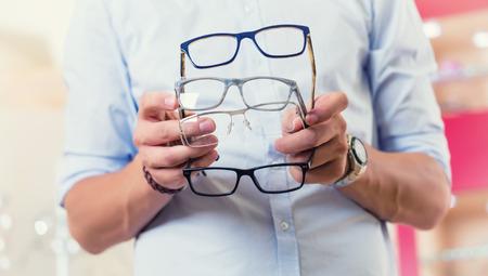 optometrist: Man at optician or optometrist buying glasses