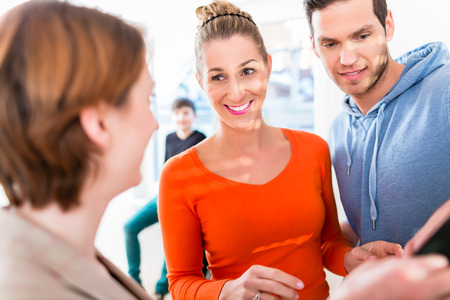 realtor: Family and realtor looking at apartment floor plan Stock Photo