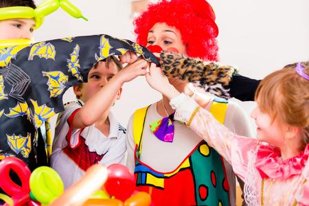 birthday party kids: Clown at children birthday party entertaining the kids