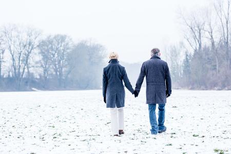 couple winter: Senior couple having winter walk Stock Photo