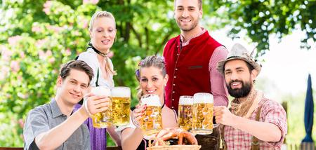 beer garden: Friends in Bavarian beer garden drinking in summer