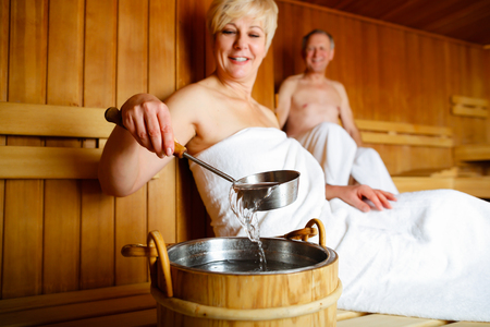 couple relaxing: Seniors in sauna sweating and relaxing Stock Photo