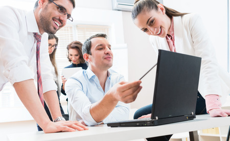 Business team reporting to boss having meeting in office Stock Photo