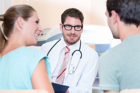 preventive: Pregnant woman and her partner seeing physician for pregnancy examination