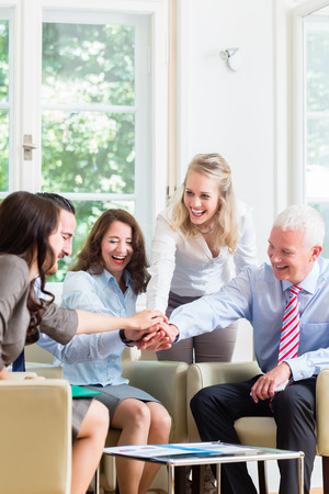 getting better: Business Team getting motivation for better work stacking hands