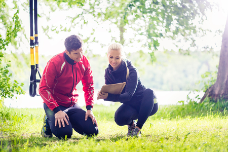 trainers: Man with personal trainer at debriefing Stock Photo