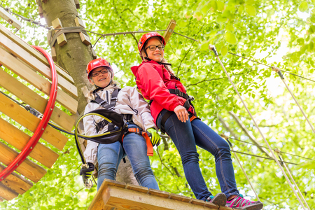 clambering: Sisters climbing in high rope course together
