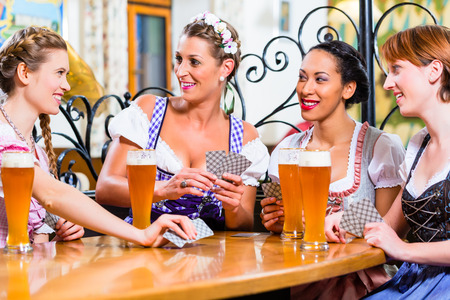 tracht: Women in Bavarian pub playing cards and a game of Schafkopf