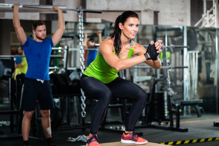 Group of men and woman in functional training gym doing fitness exercise Stok Fotoğraf