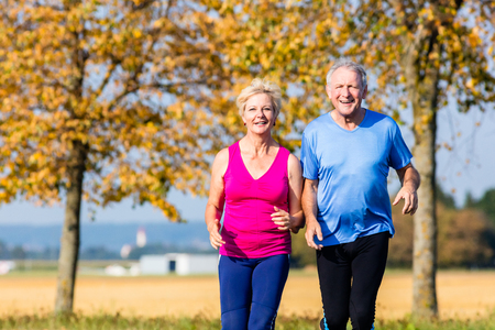 healthy men: Senior woman and man running doing fitness exercises