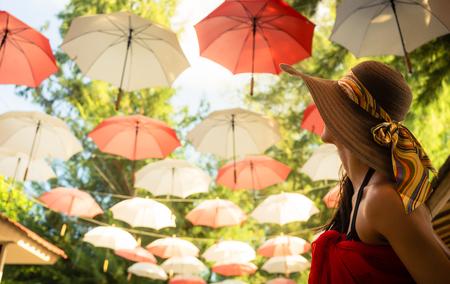 sun umbrella: Female tourist marvels at baldachin of umbrellas