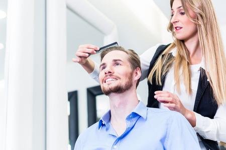 haircutter: Haircutter cutting hair of customer