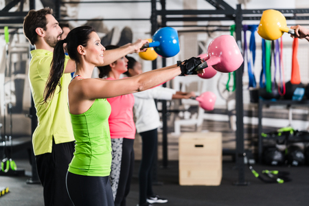 Functional fitness workout in sport gym with kettlebell Stockfoto