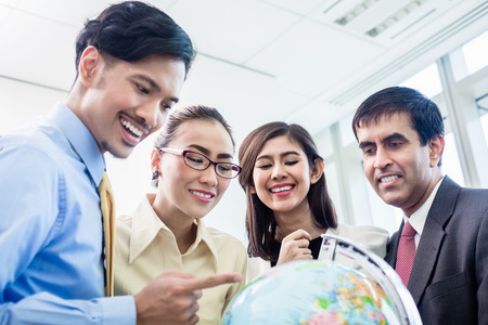 asia people: Asian businesspeople in office talk about global strategy and new markets Stock Photo