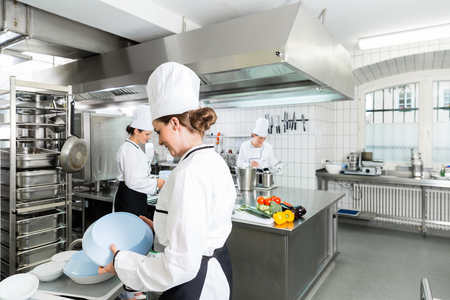 Commercial kitchen with chefs cooking