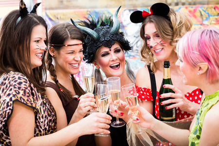 chink: Girls at Carnival parade clinking glasses with champagne