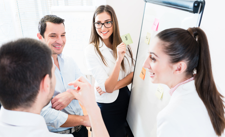 creative planning: Sales Team at business meeting in office planning creative with sticky notes Stock Photo