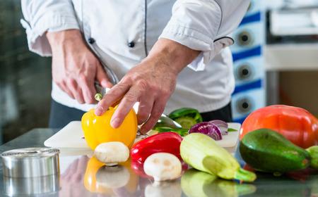 cutting: Chef cutting vegetables in his restaurant kitchen