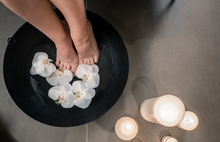 traditional: High angle close-up view of female feet during Asian therapeutic washing at luxury beauty center