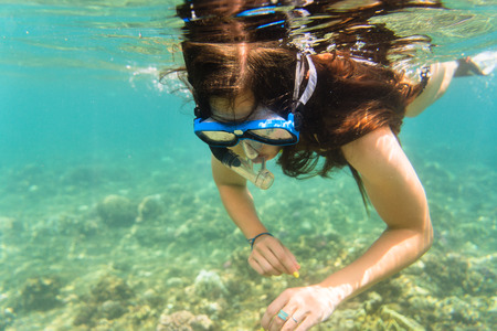 ocean waves: Girl in bikini snorkelling in tropical sea