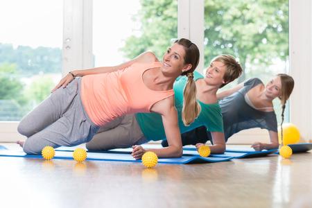 regression: Women doing exercises for pelvis floor in postnatal regression course