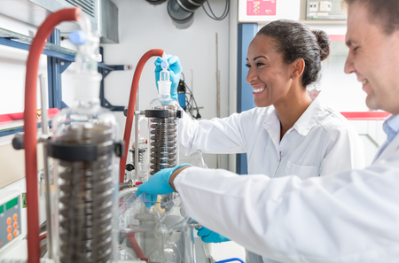 black appliances: Researchers preparing test in scientific laboratory