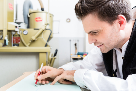 Craftsman cutting out pattern for stone engraving