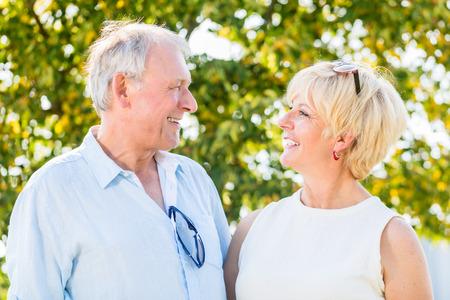 Senior couple, woman and man, having walk