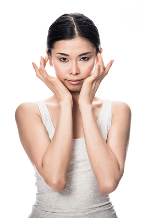 Portrait of Asian young woman looking at camera with an intelligent facial expression Stock Photo
