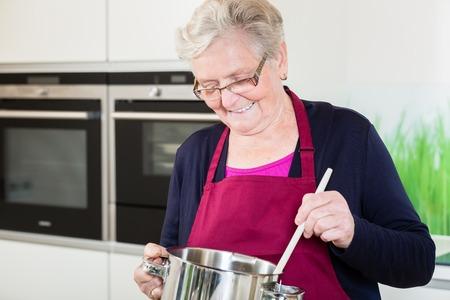 comfort food: Grandma cooking comfort food in her kitchen Stock Photo