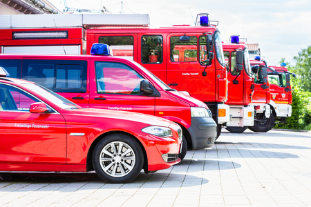 Car pool with fire engines of fire department Archivio Fotografico