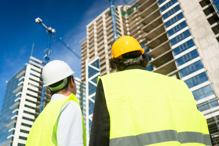buildingsite: Architects or civil engineers visiting construction site