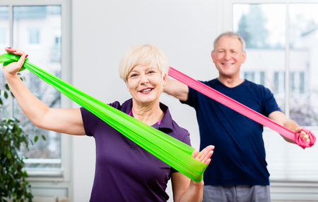 Older patients in physiotherapy using power band for strength training