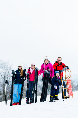 Family in winter vacation doing sport outdoors Stock Photo